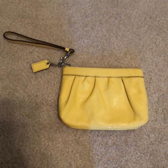 Coach Handbags - Yellow Coach wristlet